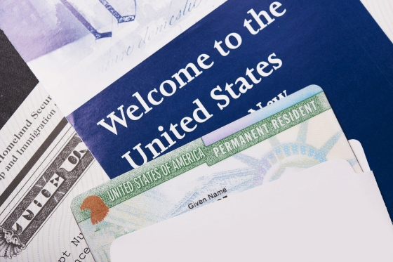 Welcome to the USA. Immigration Welcome Letter and Green Card Closeup. United States Homeland Security.